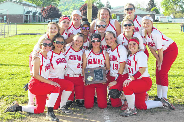 Members of the Class A Region IV, Section 1 champion Wahama softball team pose with the championship plaque, following the Lady Falcons' 3-0 victory over Ravenswood on Wednesday in Hartford, W.Va.