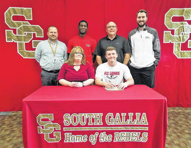 On April 26 at SGHS, senior Nick Hicks signed his National Letter of Intent to join the Rio Grande men's basketball team. Sitting in the front row, from left, are Corrina Conley and Nick Hicks. Standing in the back row are SGHS Principal Bray M. Shamblin, RedStorm basketball coach Corey Harris, Rebels head basketball coach Kent Wolfe and RedStorm basketball coach Cal Cistaro.