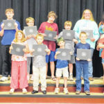 Archery team, students recognized by board