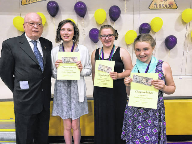 Former Southern Local Elementary Principal and Meigs County Sheriff Robert Beegle, on behalf of the Middleport-Pomeroy Rotary Club, presented three Southern Local Elementary students with a certificate and money in recognition of their academic achievements. The students had their names drawn from the grades 4-8 students at the recent Southern Local Academic Banquet. This is the 28th year for the Rotary to make presentations at the banquet. Pictured are Beegle, eighth grader Terin Reiber, eighth grader Tori Brewster and fourth grader Allison Bradbury.