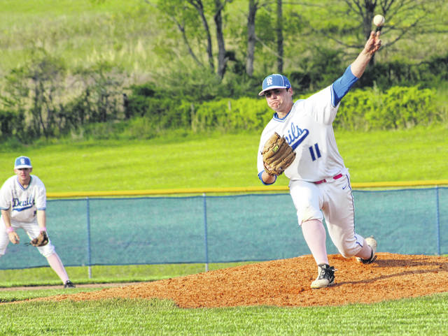 Gallia Academy senior Josh Faro (11) releases a pitch during an April 29 OVC baseball contest against Coal Grove at Bob Eastman Field in Centenary, Ohio. Teammate and fellow senior Wyatt Sipple is also pictured in the background.