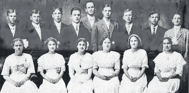"The Syracuse Class of 1912 graduates are pictured in this group photo from the collection of Bob Graham. The class list on the back of the photo reads ""Class of 1912 First Row-Left to Right- Clara Ables Rizer, Maude Cross Butterfield, Eugenia Ogden Dutte, Carolyn Ellis Thomas, Myrtle Philson Turnbull, Grace Sayre Krider. Second Row-Ivan Pickens, Walter Casto, Clark Jividen, Clifford Roush (deceased), Charles Roberts, David Blake, Harry Manuel, John Burnell. Absent-Cora Stobart Buck."""