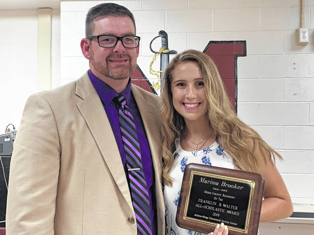 Marissa Brooker, the Franklin B. Walter award recipient, received her award from Daniel Otto, Southern High School Principal.