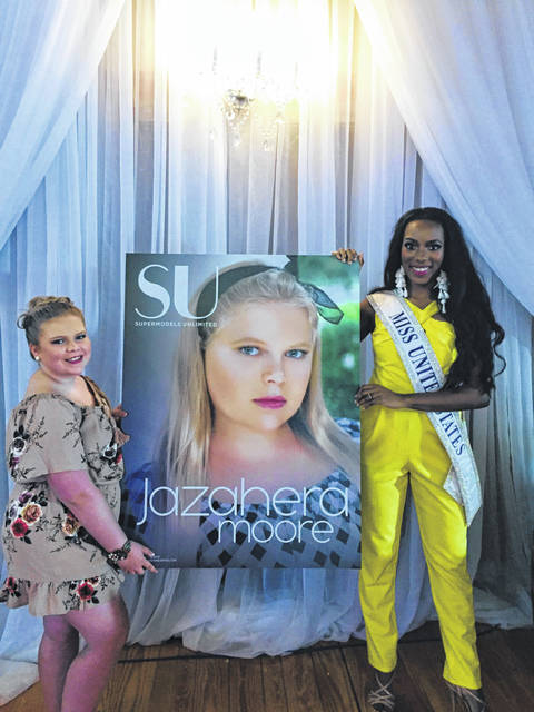 Jazahera Moore is pictured with Miss United States.