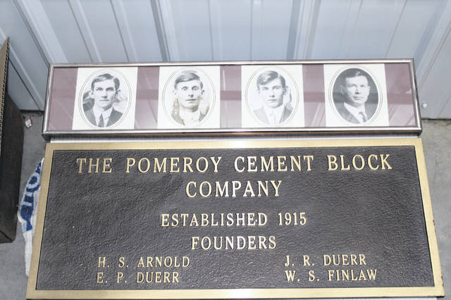 The plaque from the Pomeroy Cement Block Company, along with the photos of the founders will be displayed in the new Dettwiller Lumber store.