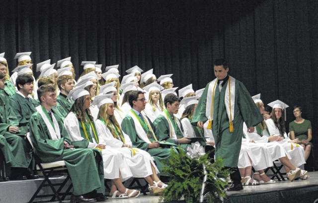 Eastern High School Class of 2019 President Sharp Lee Facemyer crosses the stage after giving the welcome during Sunday's commencement exercises.
