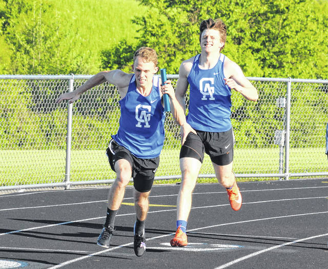 Gallia Academy senior Bo Saxson, left, takes off after receiving a baton exchange from junior teammate Ryan Donovsky during the 4x200m relay event held at the 2019 Battle for the Anchor on May 6 in Centenary, Ohio.