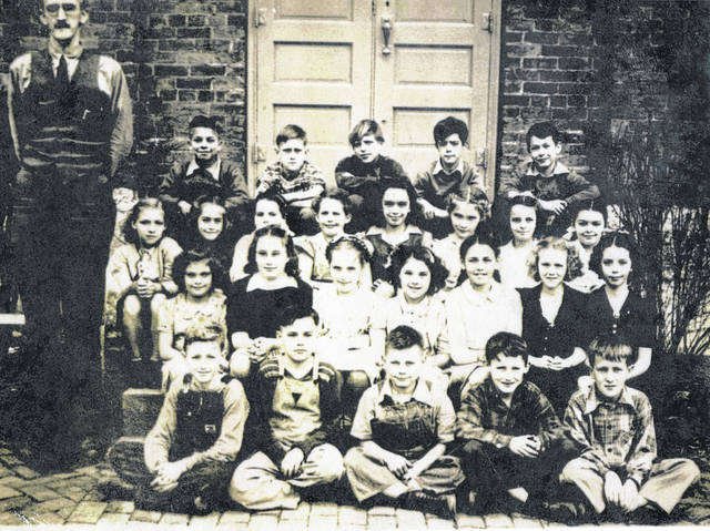 This photo from the Collection of Bob Graham shows what is believed to be a 5th grade class at Sugar Run Elementary School. The class is pictured with their teacher, Mr. Bob Roberts. According to the information with the photograph, the one known student pictured is Tommy Smith, far right in the front row. The final photo in our series of school related Throwback Thursday photos will appear in next Thursday's edition of <em>The Daily Sentinel</em>.