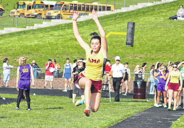 MHS senior Kassidy Betzing soars through the air in a long jump attempt, during the Meigs Relays on April 16 in Rocksprings, Ohio.