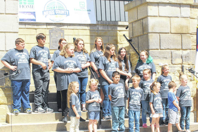 A large crowd, including students from area schools, were part of the National Day of Prayer observance held at the Meigs County Courthouse on Thursday. Pictured are students from Mid Valley Christian School in Middleport and Meigs Local Schools. As part of the ceremony, multiple local individuals and students performed musical selections, while individuals turn turns praying for local, state and national officials and many others.