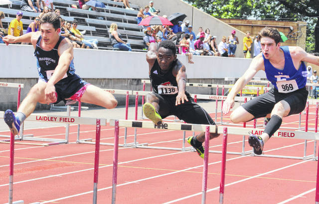 Point Pleasant junior Kaydean Eta, middle, clears an obstacle during the 2019 Class AA 110m hurdles final held Saturday at Laidley Field in Charleston, W.Va.