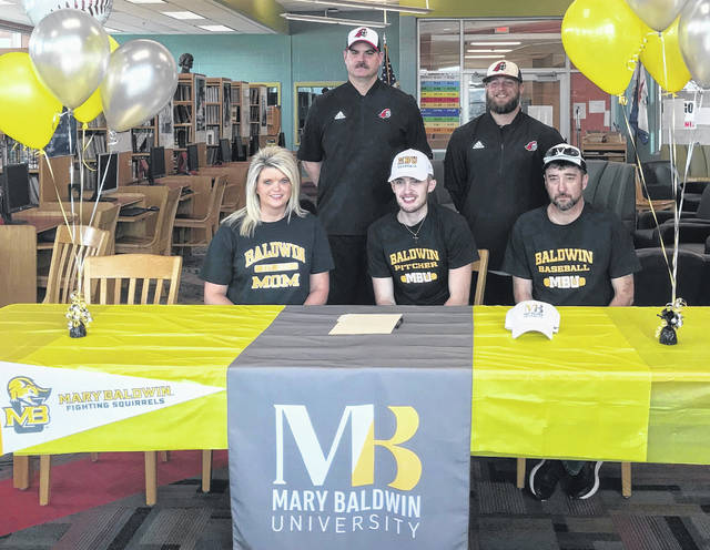 Point Pleasant senior Levi Mitchell, seated center, will be continuing his baseball career after signing with Mary Baldwin University on March 17, 2019, within the PPHS library in Point Pleasant, W.Va. Joining Levi at the table are his parents, Summer and Doug Mitchell. Standing in back are PPHS assistant coaches Bryan Morrow and Dante Fuscardo.