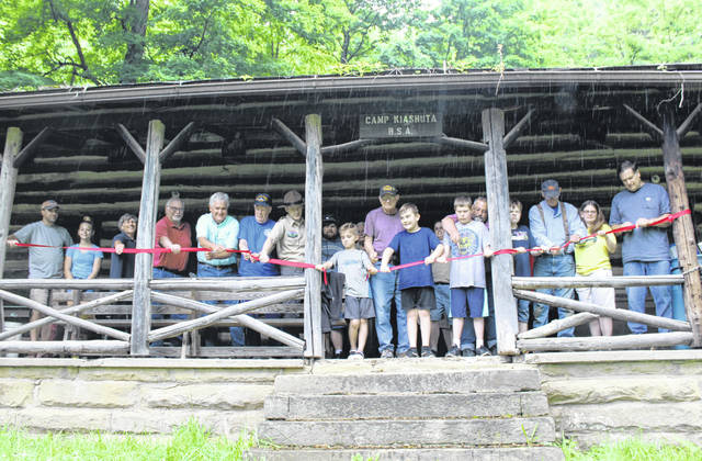 Several current and former Boy Scouts and leaders, as well as members of the community and the Friends of Camp Kiashuta were on hand at the camp Saturday for the official transfer of the property back to local ownership. In keeping with the Boy Scout focus, pocket knives were used to cut the ribbon rather than scissors.