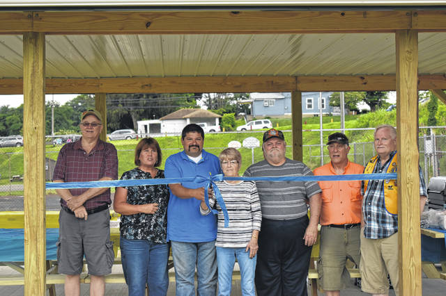 Representatives from the Pomeroy-Middleport Lions Club were joined by Brenda Barnhart, Middleport Mayor Sandy Iannarelli and Village Administrator Joe Woodall for the ribbon cutting of the new shelter house.