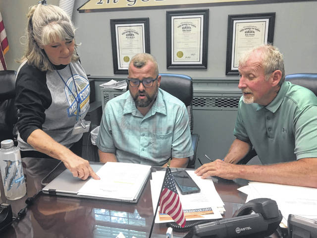 Meigs County Victim Assistance Director Theda Petrasko presents her annual report to Commissioners Randy Smith and Tim Ihle.