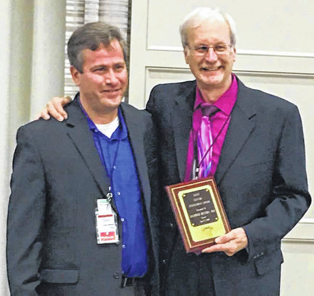 Dr. Raymond C. Matura (right) receives the Ohio Association of Gerontology and Education 2019 Lifetime Achievement Award from Dr. Daniel Van Dussen, professor and graduate director of gerontology, Youngstown State University and president of Ohio Association of Gerontology and Education.