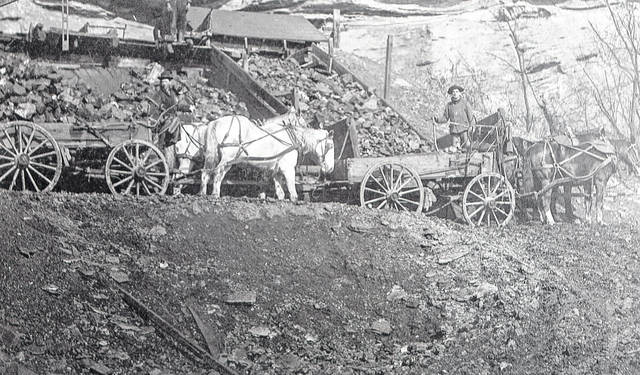 This photo from the Collection of Bob Graham shows Peacock Coal Company loading coal onto horse-drawn carts around 1910. According to the information on the back of the photo, pictured are Bill Wickham and Owen Duffy, both of Pomeroy. Duffy, in notes, worked for Peacock Coal for 32 years and retired when the company went to the use of trucks. Pictures like this one from Graham's collection can be found at the Meigs County Historical Society and Museum, as well as through the Meigs County District Public Library website.