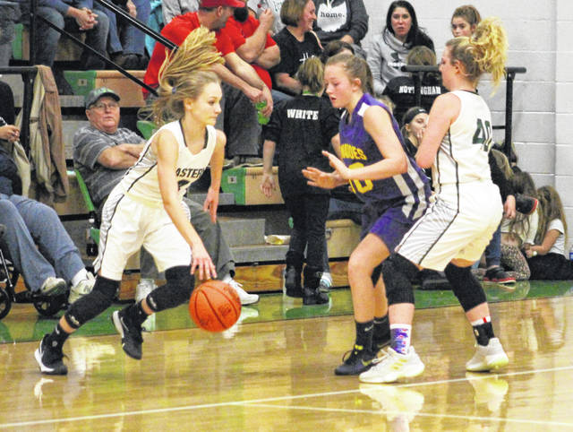 Eastern sophomore Ashton Guthrie, left, dribbles past a Southern defender during a January 7 girls basketball contest in Tuppers Plains, Ohio. The Lady Eagles will enter new territory this winter after being bumped up to the Division III level in girls basketball.