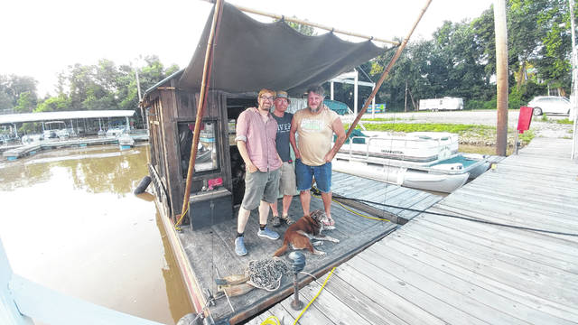 Pictured are shantyboat riders and A Secret History of American River People colleagues from left to right, Jeremiah Daniels, Wes Modes and Adrian Nankivell.