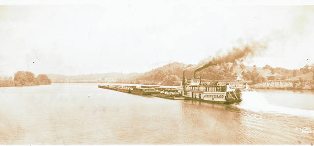 This photo from the Collection of Bob Graham shows the sternwheeler, John W. Hubbard, pushing barges down the Ohio River past Minersville, Ohio. While sternwheelers are no longer used to move barges up and down the Ohio River, the boats can be seen in town during the annual Pomeroy Sternwheel Regatta or making trips on the Ohio River during the summer months. Graham's photos, including several of the Ohio River and flooding in the region may be viewed at the Meigs County Historical Society's Museum and on the Meigs County District Public Library website.