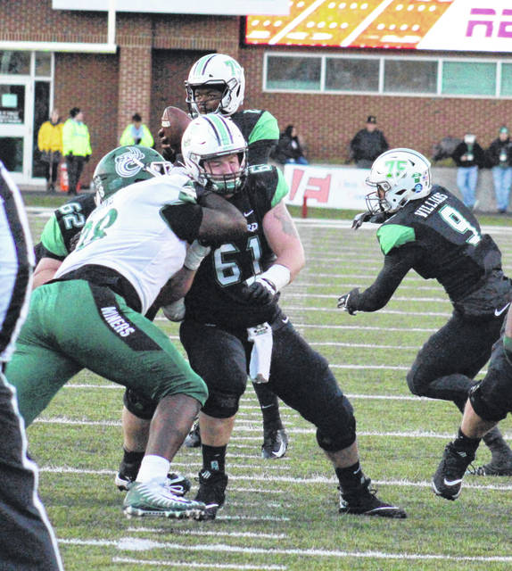Marshall's Levi Brown (61) blocks a Charlotte defensive tackle, during the Nov. 11, 2018, contest in Huntington, W.Va.