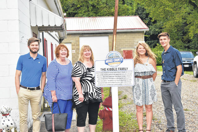 The Olive Twp. Bicentennial Marker was unveiled on Wednesday evening to commemorate the Kibble family. Pictured are (left to right) Bicentennial Ambassador Grant Adams, Kibble descendants Pat Smith-Drake and Diana McLevey, and Bicentennial Ambassadors Brielle Newland and Cooper Schagel.