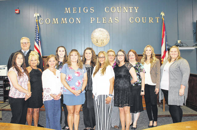 Meigs County's newly sworn-in CASAs are pictured following the ceremony on Thursday along with Judge Scott Powell and Program Director Chelsey Kloes.