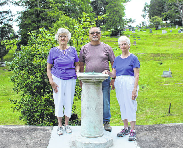 The Pomeroy Alumni Association recently placed the sundial, purchased by the Class of 1927, in Beech Grove Cemetery. Pictured are Alumni Association Secretary Marcia Arnold (Class of 1958), President Bill Young (Class of 1961) and Executive Committee Member Mary Jane Wise (Class of 1956).