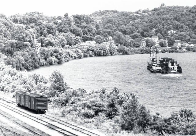 This photo from the Collection of Bob Graham shows a towboat on the Ohio River as a pair of train cars sit on the tracks along side. The undated photo shows the area between the then Pomeroy-Mason Bridge and downtown Pomeroy as it was many years ago. Photos, such as this one, from Graham's collection may be viewed at the Meigs County Historical Society Museum or on the Meigs County District Public Library website.