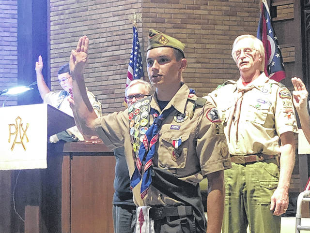 Adam Stout swearing in as an Eagle Scout.
