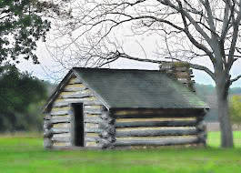 A log cabin like what would have been built in the 1800s.