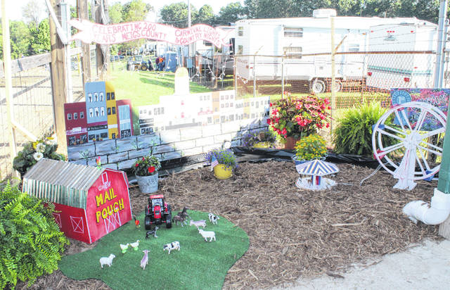 Each year the 4-H clubs involved in the Meigs County Fair select an area of the Fairgrounds to decorate as part of the Landscape contest. The winners for this year were 1st place, Meigs Creek (downtown Pomeroy design at Dairy Barn entrance); 2nd place, Country Pioneers (Making Rounds at the Fair photo stop near the Commercial Building); and 3rd place, Cowboy Boots and Country Roots (area near the Thompson Roush Building).