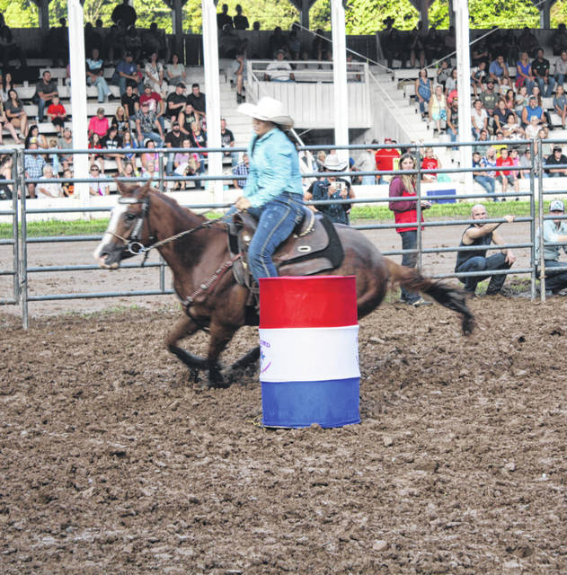 Several riders from around the country rode for the money in barrel racing during the Bulls and Barrels Rodeo Tuesday night. The event was held before the grandstand at the 156th Meigs County Fair.