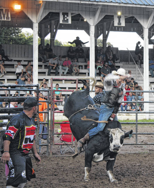 The Bulls and Barrels Rodeo was held before the grandstand Tuesday night. The rodeo featured riders from all over the country trying to tame the bulls for the eight second ride.