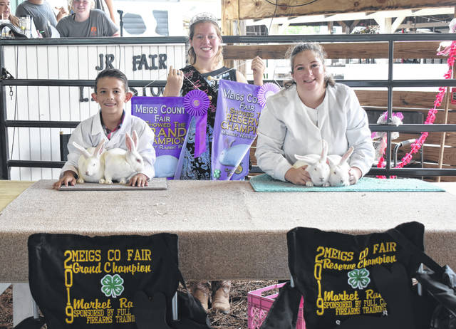 The Grand Champion Market Rabbits were shown by Brenen Rowe, and the Reserve Champion Market Rabbits were shown by Gabrielle Beeler. Also pictured is Fair Queen First Runner-Up Raeven Reedy.
