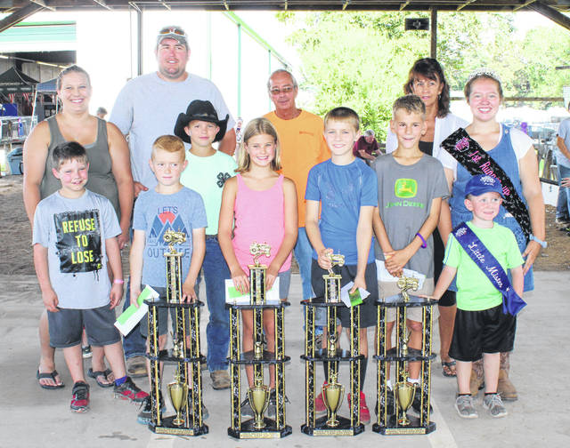 The 56-75 pound class winners of the Meigs County Fair Kiddie Tractor Pull of Champions were (pictured from left with their trophies) John Turley, Brooke Marcinko, Jake DeWees and Nolan Blake. Also pictured are sponsors and Meigs County Fair Royalty.