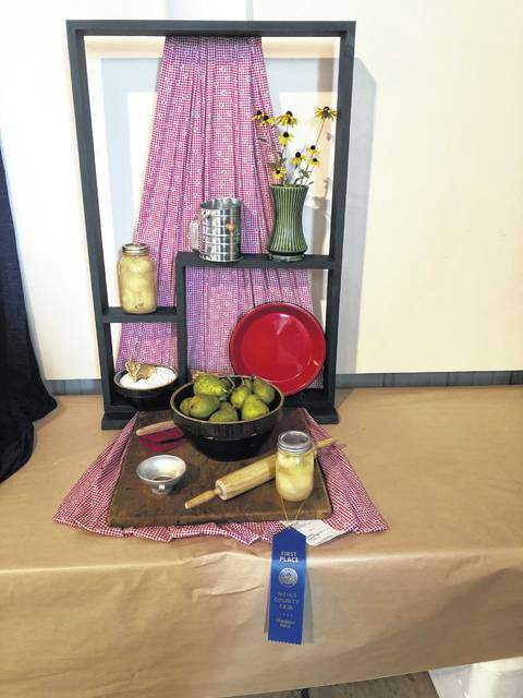 Josephine Hill was awarded Best of Show for her Still Life titled Baking and Canning.