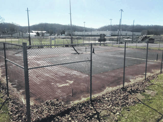 Tennis courts at General Hartinger Park are pictured before repairs.