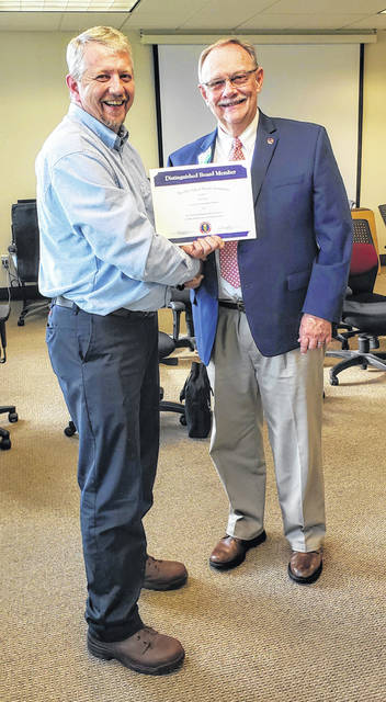 Paul Mock, OSBA South Eastern Regional President, is pictured recognizing Mr. Ryan Mahr on 10 years of service on the Meigs Local Board of Education.