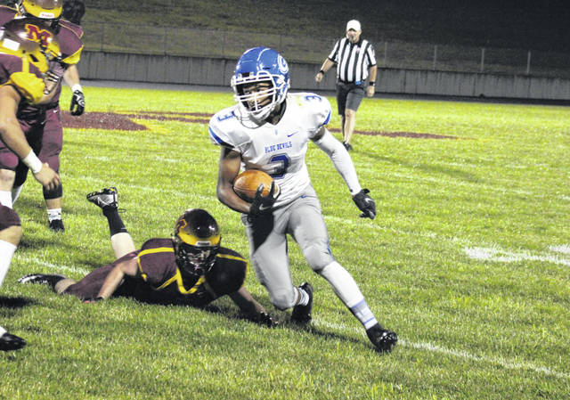 Gallia Academy junior James Armstrong (3) turns up field, during the Blue Devils' 24-0 victory on Friday in Rocksprings, Ohio.