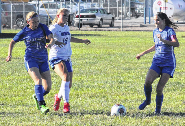 Gallia Academy's Kyrsten Sanders (21) passes to teammate Brooke Johnson (7), during the first half of the Blue Angels' 4-0 win on Thursday in Centenary, Ohio.