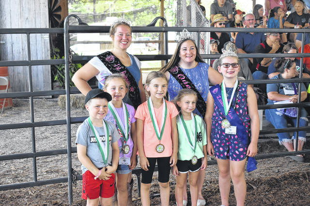 Cloverbud members of Busy Beavers 4-H club who participated in the Cloverbot Challenge in Columbus are pictured with Fair Royalty.