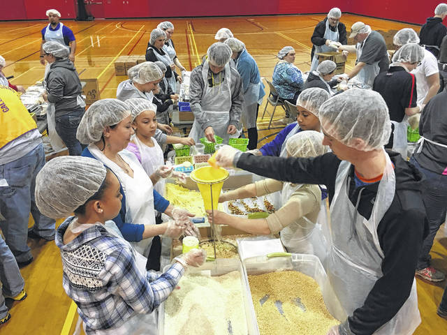 Volunteers of all ages in 2016 from local churches in Gallia, Meigs and Mason counties converged on the University of Rio Grande and Rio Grande Community College gymnasium to help package nearly 15,000 ready-to-eat meals for people in starving countries. The 15,000 packs that were put together at URG were headed to Ghana, a small country in western Africa.
