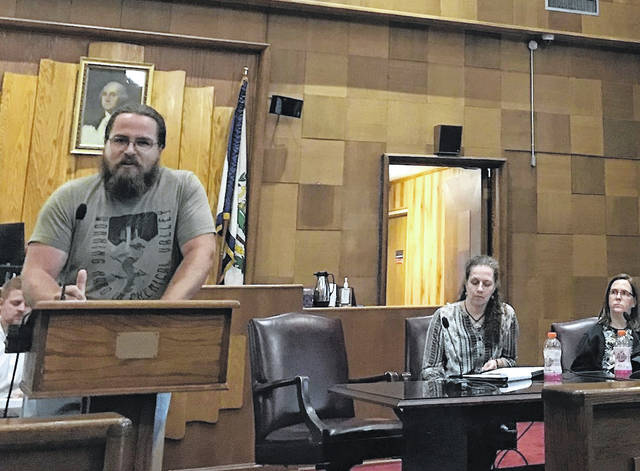 Alex Cole of Mason County speaks out against the plant proposed by Domestic Synthetic Fuels north of Point Pleasant. Members of the West Virginia Division of Environmental Protection are pictured in the background.