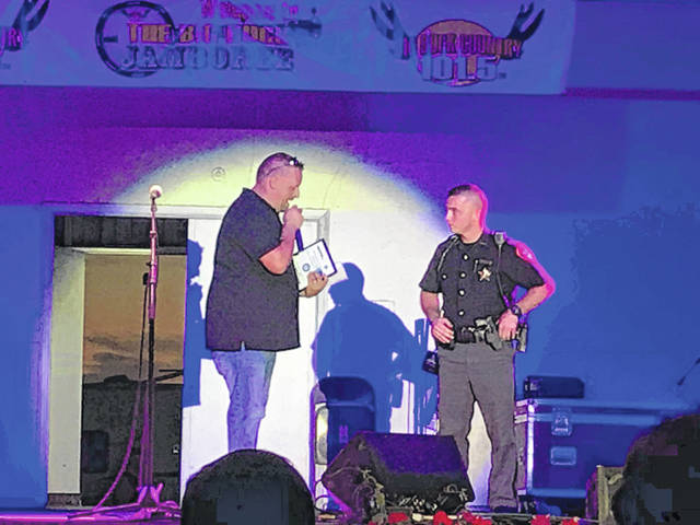 Josh Wellington of Kindred Communications addresses Gallia Sheriff's Deputy Nick Clagg during the Gallia Junior Fair.