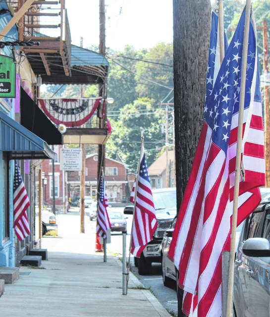 Flags lined the streets of Pomeroy on Wednesday, while American Flags at many buildings were flown at half-staff to mark the 18th anniversary of the Sept. 11 terrorist attacks.