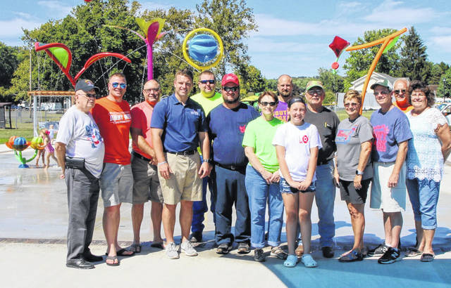 Pictured at the Splash Pad Dedication are (from left) Bob Beegle, Jimmy Will, Kevin Dugan, Jay Edwards, Ian Wise, Scott Hill, Mel Weese, Chad Hubbard, Laynee Hill, Dale Hart, Tonja Hunter, John Hoback, Gary Roush, and Teri Roush.