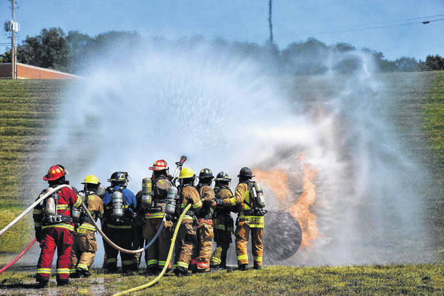 Firefighters take part in the propane gas emergencies class. (Photo by Gary Coleman)