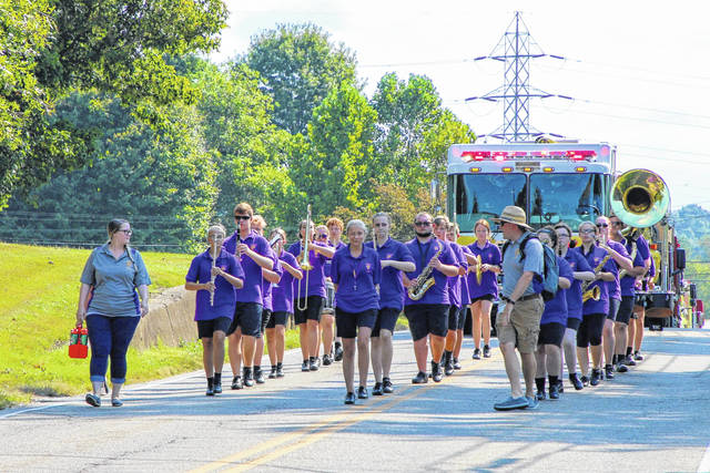 The Southern Marching Band makes their way through the parade route during the Party in the Park Parade on Saturday.