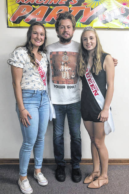 Party in the Park royalty Queen Mickenzie Ferrell (right) and First Runner-Up Baylee Wolfe (left) are pictured with headliner Brandon Lay before his performance on Saturday evening.